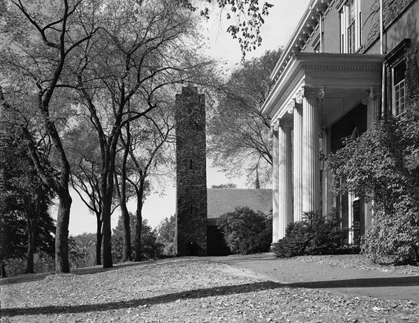 Black and white photo of the side view of Ballou Hall and Goddard Chapel, 1950.